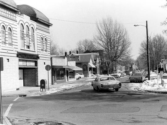 Haynie's Corner in the early 1970's. A car drives past the Alhambra Theatre at the intersection of Parrett Street and Adams Avenue. This is before Parrett Street was turned into a walkway.