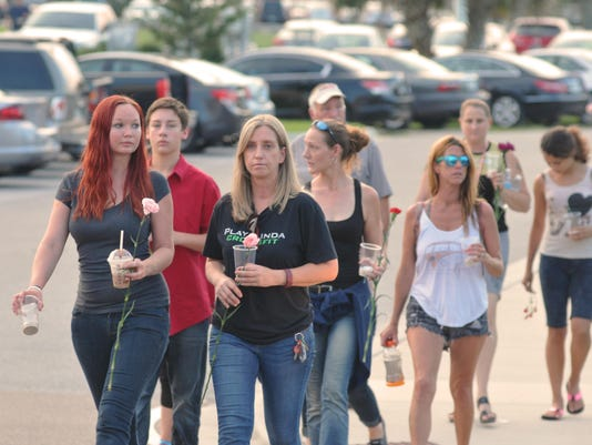 Titusville Vigil For Terror Victims Draws Crowd