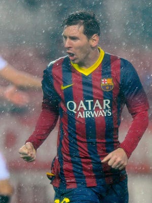 Barcelona's Lionel Messi celebrates after scoring one of his two goals against Sevilla.
