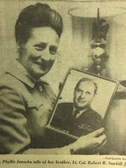 Phyllis Janocha holds a photo of her brother, Lt. Col. Robert R. Sawhill Jr. This picture appeared with a story in an undated issue of the Pittsburgh Post-Gazette.