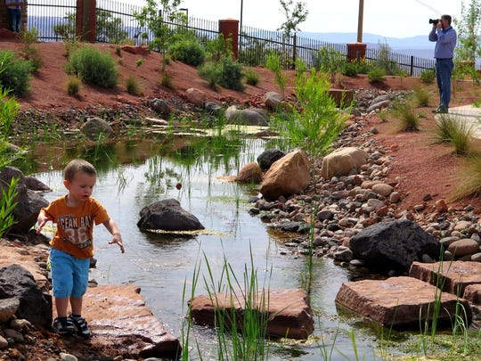 Two-year-old Maxwell Kearl and his family were some of the first visitors Wednesday to the newly-opened Red Hills Desert Garden, an interpretive park and conservation garden located along Red Hills Parkway on the cliffs above central St. George.