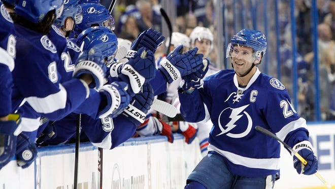 Martin St. Louis celebrates the first of his two goals.