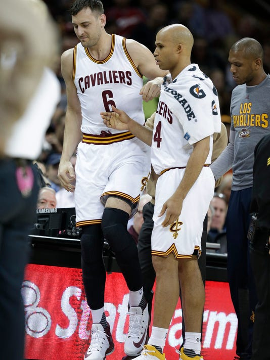 Cleveland Cavaliers' Andrew Bogut (6) is helped up by Cleveland Cavaliers' Richard Jefferson (24) in the first half of an NBA basketball game against the Miami Heat, Monday, March 6, 2017, in Cleveland. Initial X-rays and evaluation of Bogut revealed a fractured left tibia. The Heat won 106-98. (AP Photo/Tony Dejak)