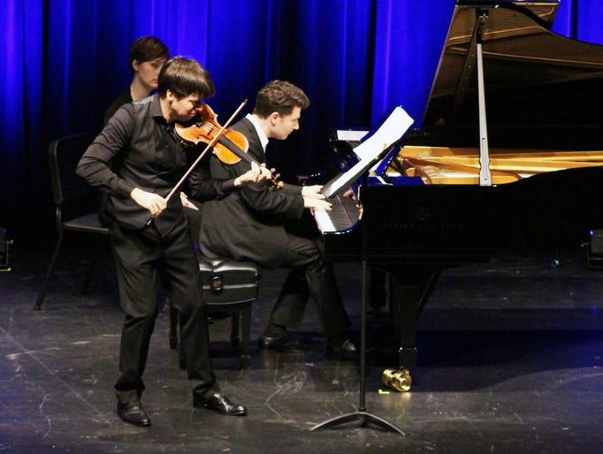 Violin virtuoso Joshua Bell performs on stage at the