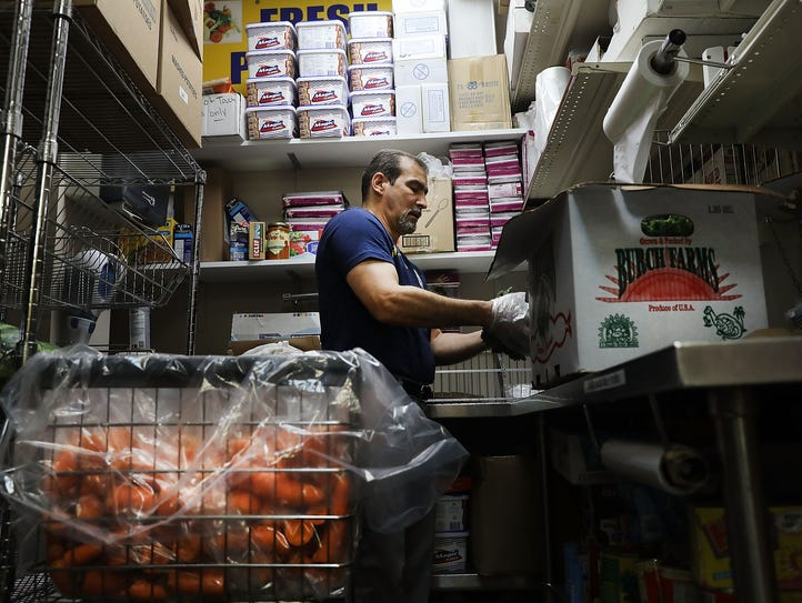 An employee sorts food at the Reaching Out Community