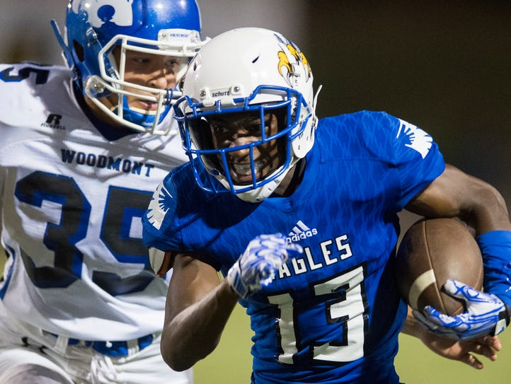 Eastside's Armani Elmore (13) gets past Woodmont's