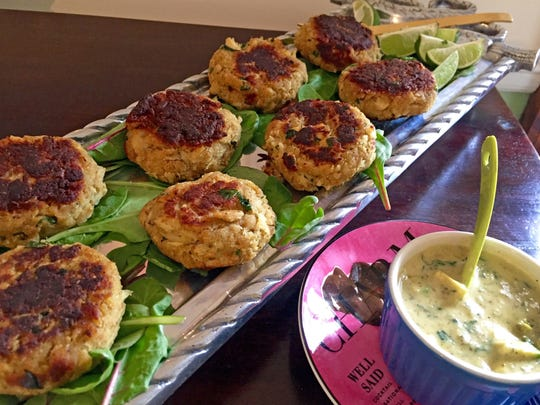 Green chile crab cakes are served with a salsa avocado sauce.