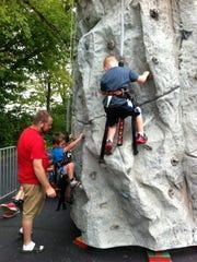 Residents enjoy rock climbing at Walton Christian Church during Old Fashion Day on Sept. 6 in Walton.