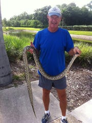 Ray Williams displays the snake.