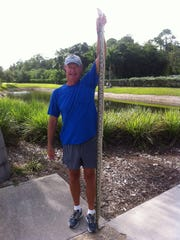 """Williams stretches the snake out to its full 8'4""""."""