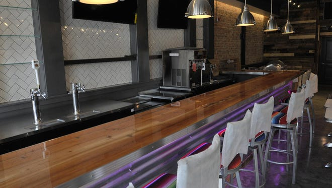 The new Cucos on Dexter Avenue features details like exposed original brick, modern tile and neon lighting.