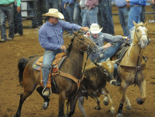 Clyde's Dalton Walker, right, competes in the steer