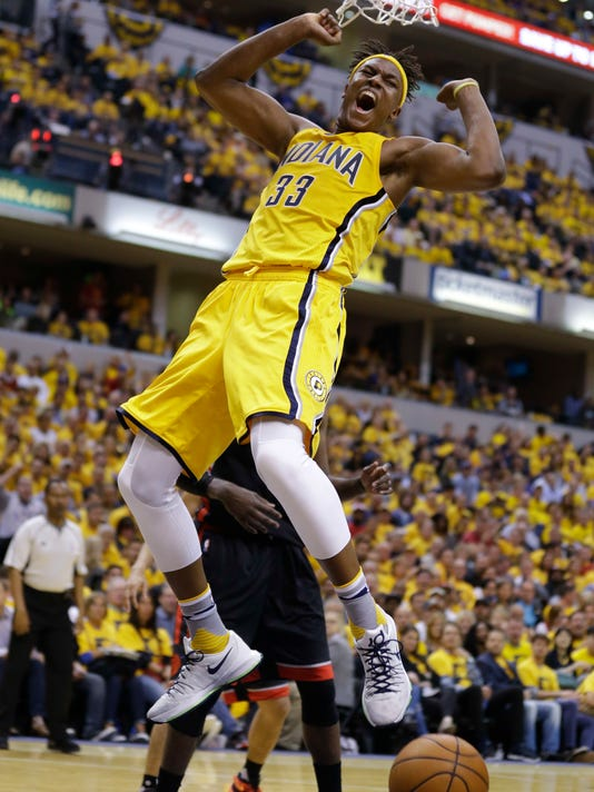 Indiana Pacers forward Myles Turner (33) react after a slam dunk against the Toronto Raptors during the second half of Game 3 of an NBA first-round playoff basketball series in Indianapolis, Thursday, April 21, 2016. The Raptors defeated the Pacers 101-85. (AP Photo/Michael Conroy)