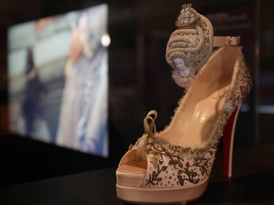 "A 2008 Christian Louboutin shoe embroidered with Marie Antoinette's portrait is on display next to a screening of a scene from the movie ""Marie Antoinette"" at an exhibit at the Brooklyn Museum in New York. ""Killer Heels: The Art of the High-Heeled Shoe"" highlights shoes from the 1600s to the present and is open from Sept. 10 through Feb. 15."