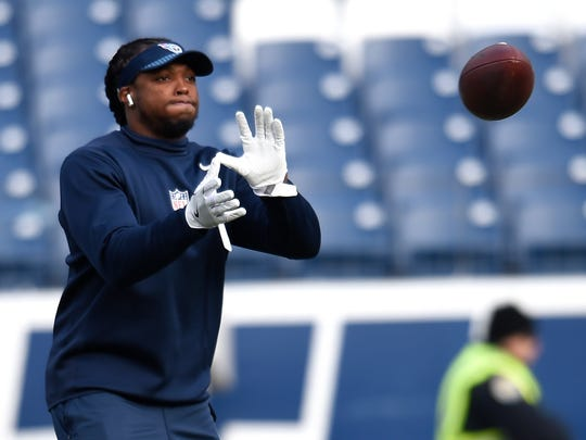 Titans running back Derrick Henry (22) warms up before