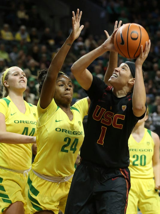 Oregon's Mallory McGwire, left, and Ruthy Hebard defend against Southern California's Jordan Adams during the first half of an NCAA college basketball game Friday, Feb. 16, 2018, in Eugene, Ore. (Chris Pietsch/The Register-Guard via AP)