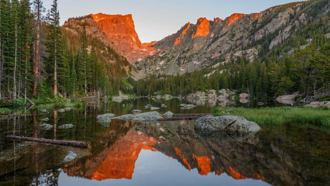 A gorgeous sunrise over Dream Lake at Rocky Mountain National Park.