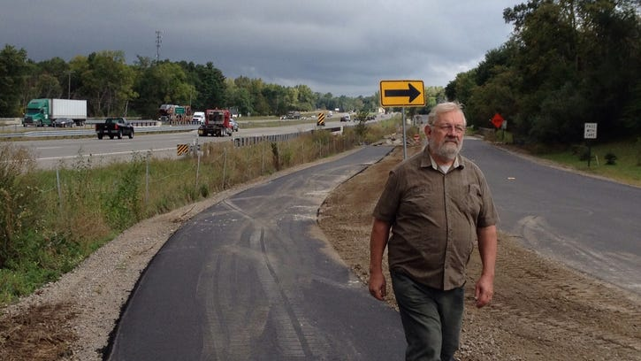 Jim Fackert walks on the new asphalt path that has become an instant hit with Green Oak Township residents. The 3-mile-long path along Fieldcrest Road was completed Sept. 6. Fackert, a longtime resident, has been an advocate for trails since the 1980s.