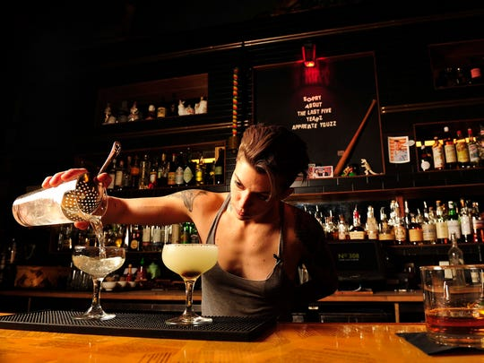 Bartender Britt Soler makes drinks at No. 308.