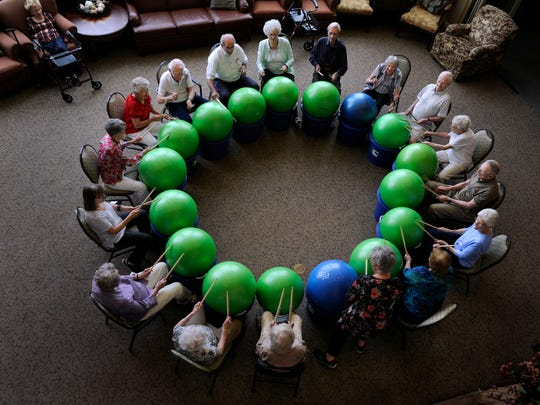 """Seniors participate in an exercise program called """"Drums Alive"""" at Wesley Court Senior Living in 2017. With the spread of the COVID-19 virus,  extra care has to be taken around older populations, especially those in groups."""