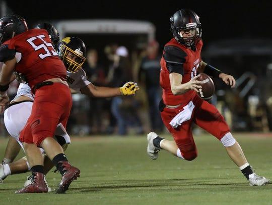 Foothill quarterback Jayden Gordon runs the ball during