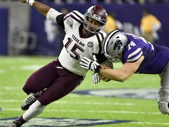 Texas A&M defensive end Myles Garrett (15) is widely regarded as one of the top prospects in the NFL draft.  (AP Photo/Eric Christian Smith, File)
