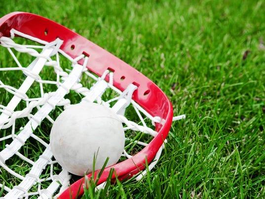 636370506021441386-lacrosse-stick-ball-grass.jpg