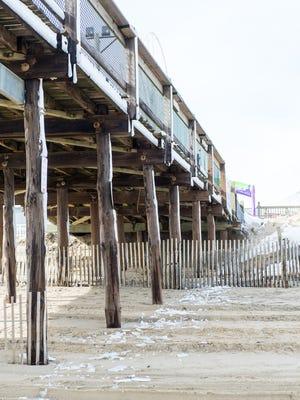The Ocean City pier lays in disrepair following weekend winter storms in Ocean City on Monday, Jan 25.