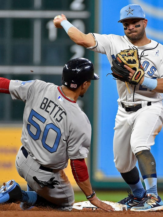 Houston Astros second baseman Jose Altuve, right, turns a double play over Boston Red Sox' Mookie Betts to end the top of the sixth inning of a baseball game, Saturday, June 17, 2017, in Houston. (AP Photo/Eric Christian Smith)
