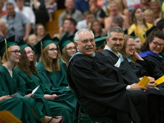 Superintendent of Schools Stan Mack, center, takes part in the commencement ceremony of Oshkosh North High School June 10, 2015.