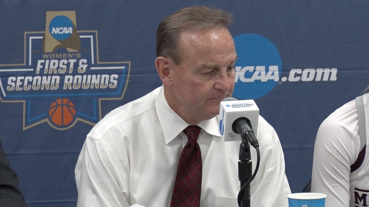Vic Schaefer embraces his wife Holly Schaefer after