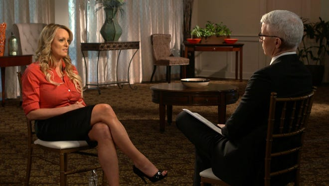 """This image released by CBS News shows Stormy Daniels, left, during an interview with Anderson Cooper, scheduled to air Sunday on """"60 Minutes."""""""