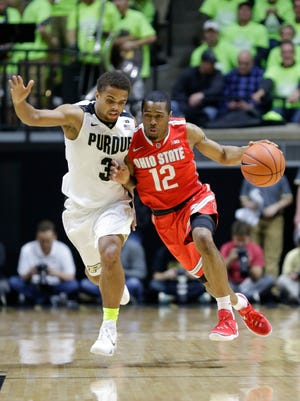 Purdue guard P.J. Thompson (3) defends Ohio State guard A.J. Harris (12) during the first half of an NCAA college basketball game in West Lafayette, Ind., Thursday, Jan. 21, 2016. (AP Photo/Michael Conroy)