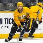 Nashville Predators center Mike Fisher (12) move the puck down the ice as the Nashville Predators practice at Bridgestone Arena  Tuesday Oct. 6, 2015, in Nashville, Tenn.