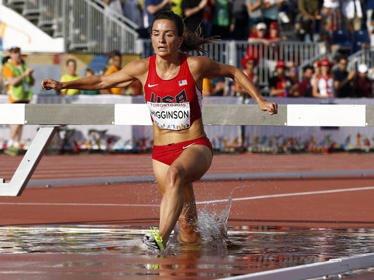 Ashley Higginson navigates the water jump on her way
