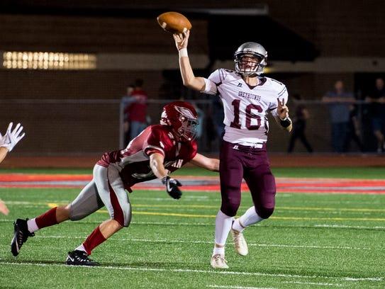 Shippensburg's Carter VanScyoc (16) gets the ball away
