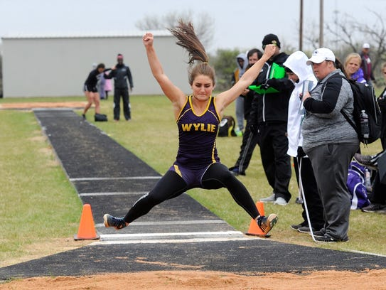 Wylie's Madi Latham takes off during the District 5-4A