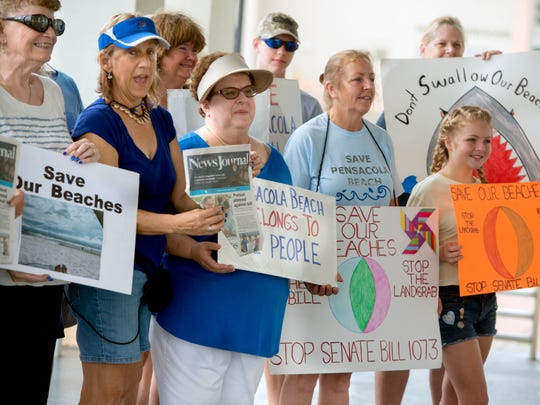 Protesters gather at the pavilion at Pensacola Beach