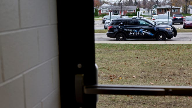 A police cruiser is parked outside during a random routine walk-through Thursday, November 12, 2015 at Port Huron High School.