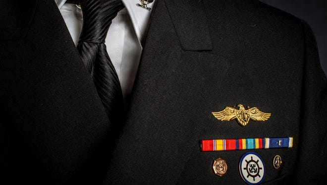 Service ribbons are displayed on Ron Kincaid's ceremonial uniform.