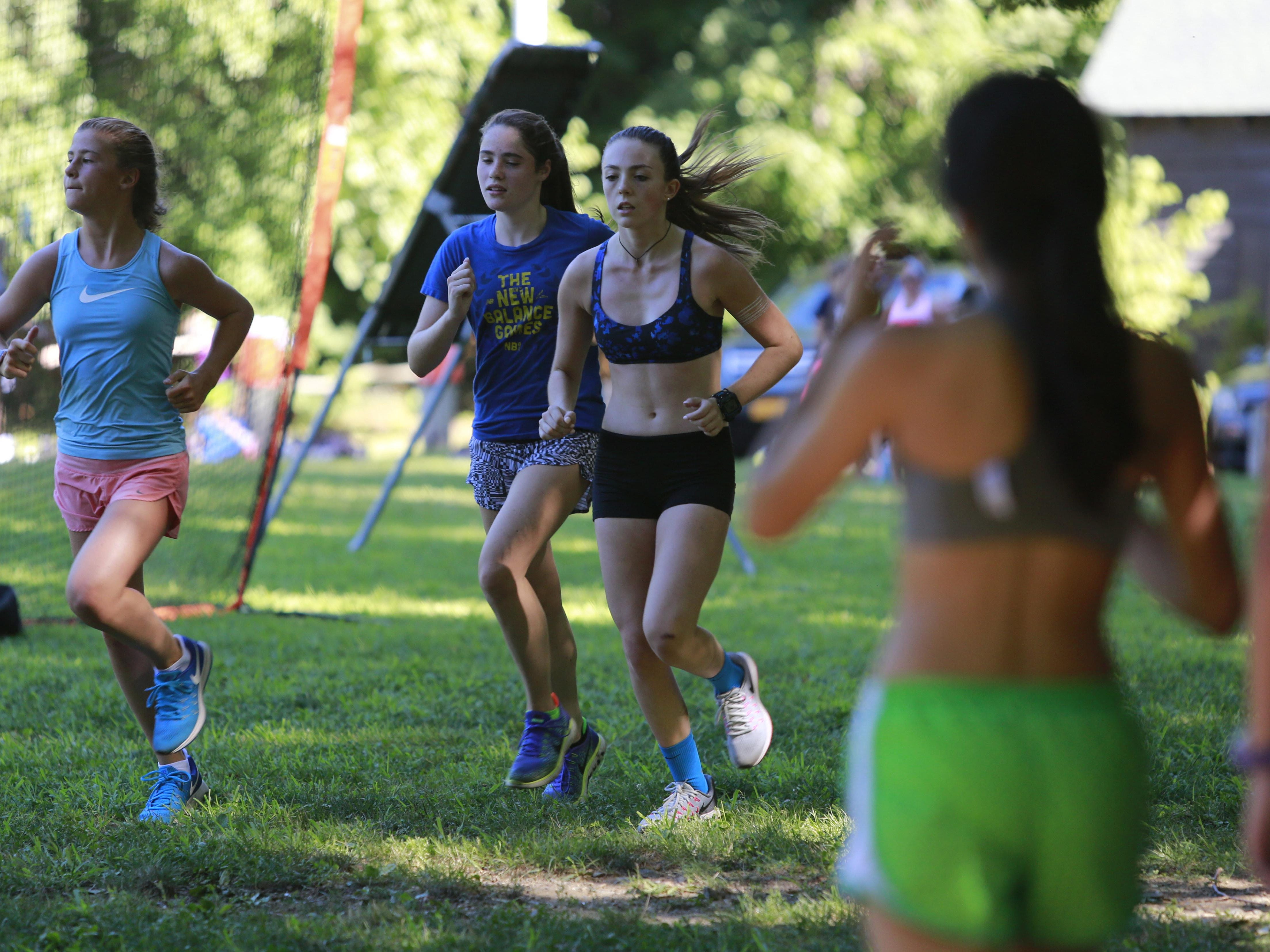 Members of the Bronxville Cross Country Track Cross Country team train at Scout Field in Bronxville on Aug. 23, 2016.