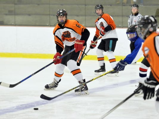 Central York/Dallastown's Carter McCormack (6) passes the puck to teammate Brayden Bailey, right, in the first period of a CPIHL hockey game Wednesday, Nov. 4, 2015, at the York City Ice Arena. Central York/Dallastown defeated Lampeter-Strasburg 8-1.