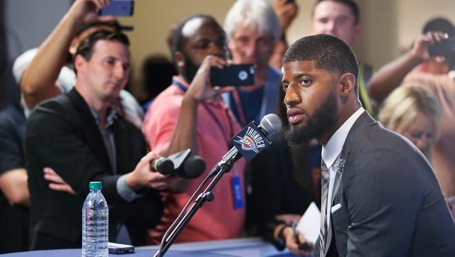 Oklahoma City Thunder forward Paul George answers a question at his first news conference since Oklahoma City's blockbuster trade with the Indiana Pacers, in Oklahoma City, Wednesday, July 12, 2017.