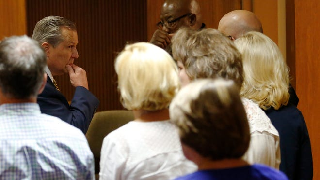 Mike Hubbard looks over at his wife Susan Hubbard while Lee County sheriffs deputies wait to take Hubbard into custody after found guilty on 12 of 23 counts on Friday, June 10, 2016  in Opelika, Ala. (Todd J. Van Emst/Opelika-Auburn News via AP, Pool)