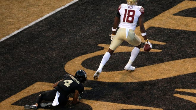 Florida State's Auden Tate (18) celebrates his touchdown catch against Wake Forest's Amari Henderson (4) late in the second half of an NCAA college football game in Winston-Salem, N.C., Saturday, Sept. 30, 2017. (AP Photo/Chuck Burton)