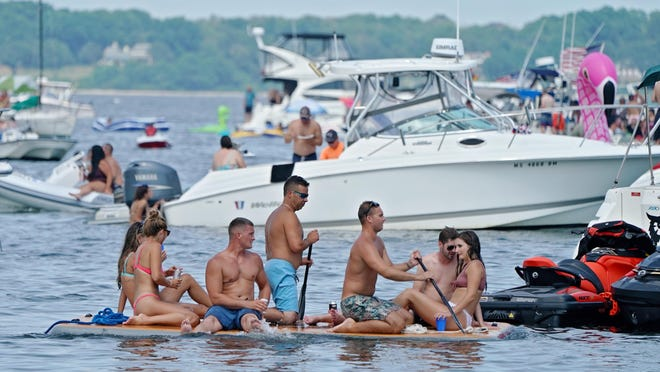 Despite law enforcement officials suggesting people stay away, Aquapoolza brought a crowd to Potters Cover Saturday.