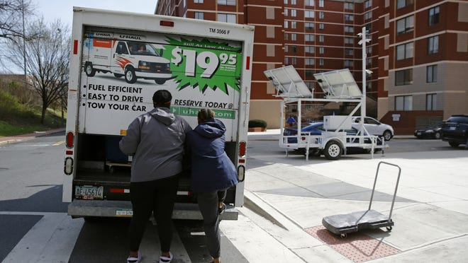 Students finish loading belongings into a U-Haul truck as they move out of their dorm in Washington.
