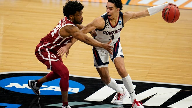 Gonzaga guard Andrew Nembhard drives on Oklahoma guard Elijah Harkless in the second half of a second-round game in the NCAA men's college basketball tournament at Hinkle Fieldhouse in Indianapolis on March 22. Nembhard played at Florida before transferring.