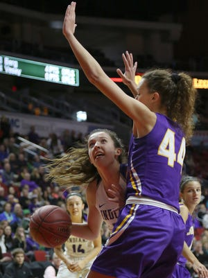 Indianola junior Grace Berg tries to get a look at the basket around Johnston senior Taryn Knuth. Top-ranked Indianola beat No. 8 Johnston 77-67 in a Class 5A quarterfinal March 1 at Wells Fargo Arena in Des Moines.