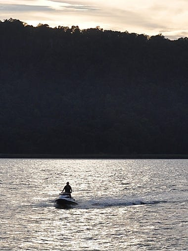 A jet skier heads home to the Yonkers Yacht Club in